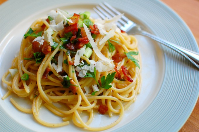 Spaghetti carbonara with bacon bits and grated parmesan cheese. | joeshealthymeals.com