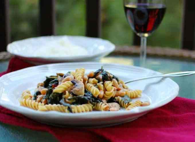 spinach mushroom pasta in a dish