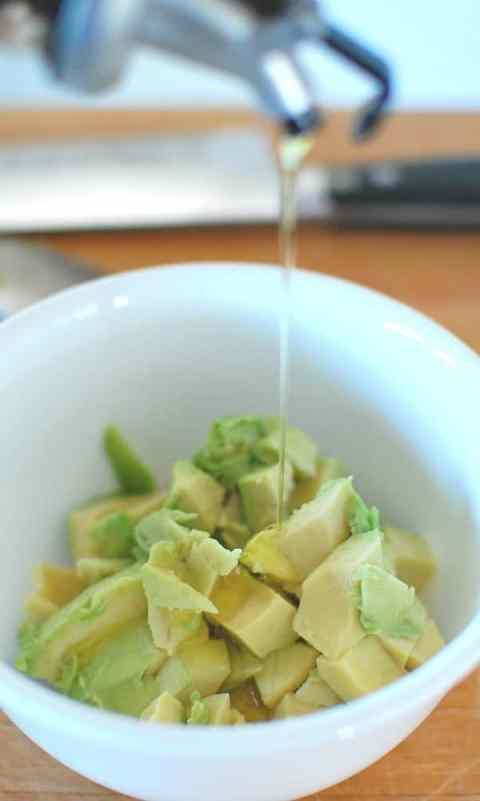 Adding oil to avocado. | joeshealthymeals.com