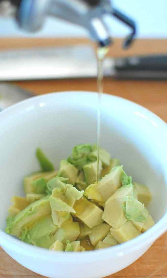 Adding oil to avocado