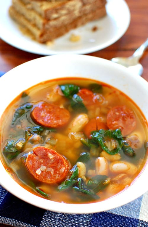 Chorizo white bean soup. This soup is full of flavor from the smokey paprika in the sausage. It is delicious with a good hearty bread. | joeshealthymeals.com