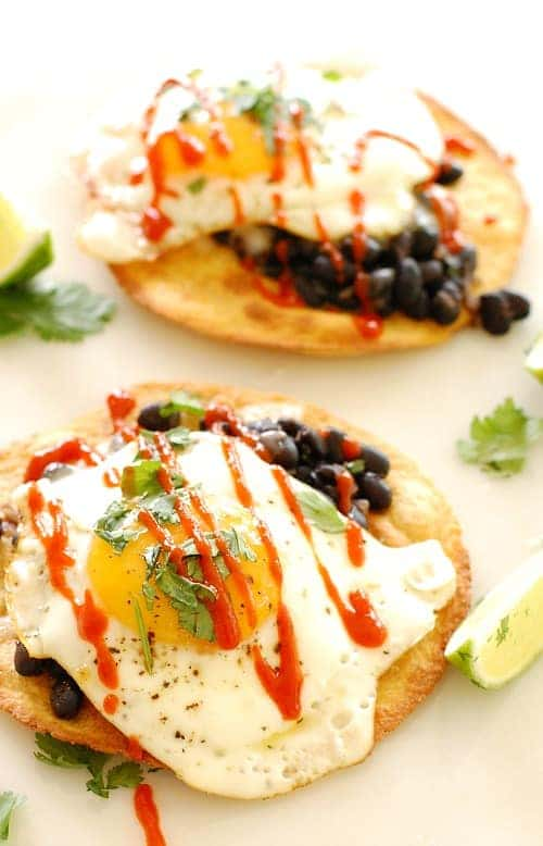 Black bean and egg tostada with sriracha. Kick up your breakfast, lunch, or dinner with this delicious tostada.   joeshealthymeals.com