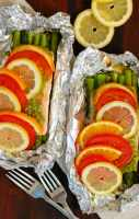 Pesto salmon with asparagus in foil. Healthy, easy way to cook your salmon. Coat the salmon with pesto and place it on top of some asparagus and bake at 400° for 25 to 30 minutes. Yum. | joeshealthymeals.com