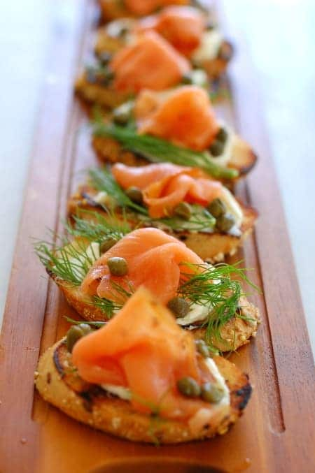 Smoked salmon, dill weed, and capers on a toasted crostini bread appetizer.