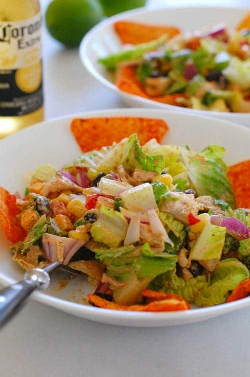 Tex-Mex chopped chicken salad. Delicious, easy rotisserie chicken salad you can make in a snap! It is made with a copycat Newman's Own Southwest Dressing recipe that has less than 50 calories per serving! | joeshealthymeals.com