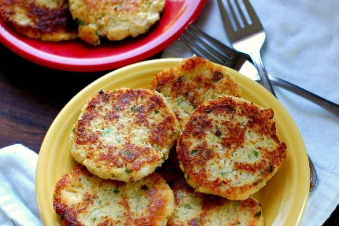 Fried cauliflower patties on a yellow plate
