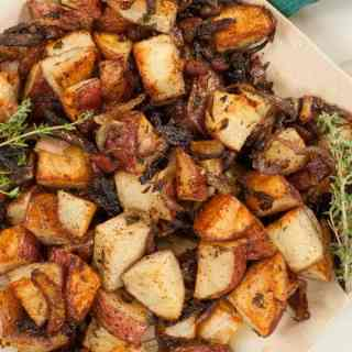 Roasted red potatoes with onions and bacon. Delicious combination of sights and smells. The bacon is wonderful. | joeshealthymeals.com