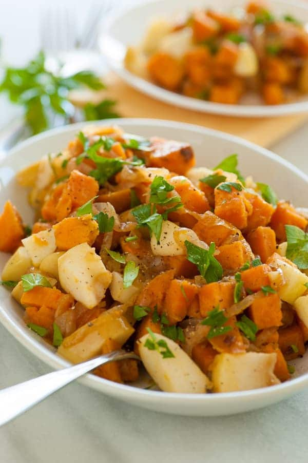 Sweet potato and caramelized onion skillet. This is a perfect recipe to serve during the holidays. | joeshealthymeals.com