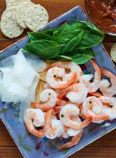 Shrimp cocktail with pickled daikon radish. Mix up some homemade cocktail sauce and treat yourself to some delicious shrimp. | joeshealthymeals.com