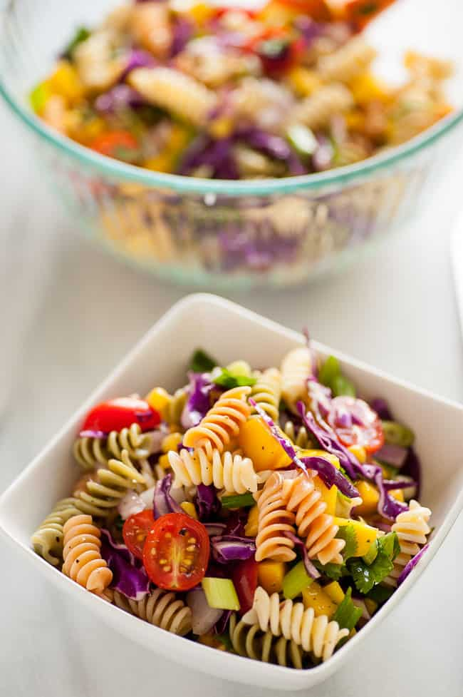 Delicious mango pasta salad. Refreshing and simple, this is a great summertime salad to have with any meal. | joeshealthymeals.com