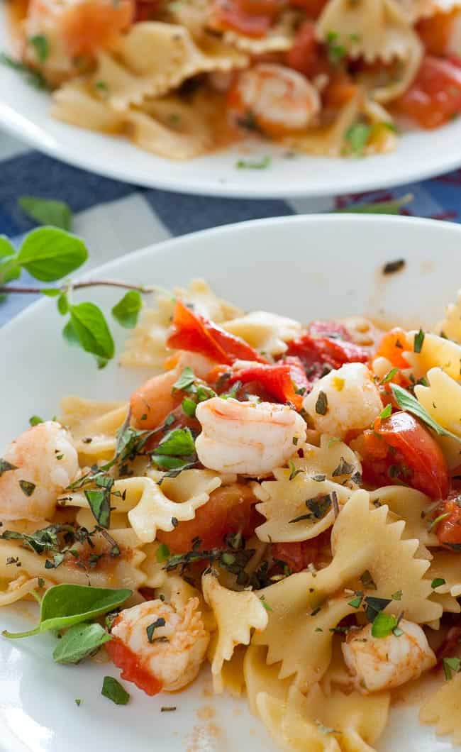 Pasta with romas and shrimp sauce. A wonderful meld of flavors produced using fresh ingredients. | joeshealthymeals.com