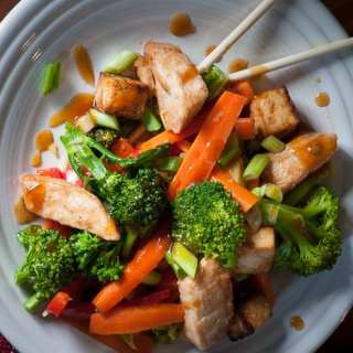 Vegetable stir fry with tofu and chicken. Easy meal idea features perfectly seasoned vegetables. | joeshealthymeals.com