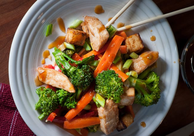 Vegetable stir fry with tofu and chicken. Tasty recipe for an Asian inspired meal. | joeshealthymeals.com