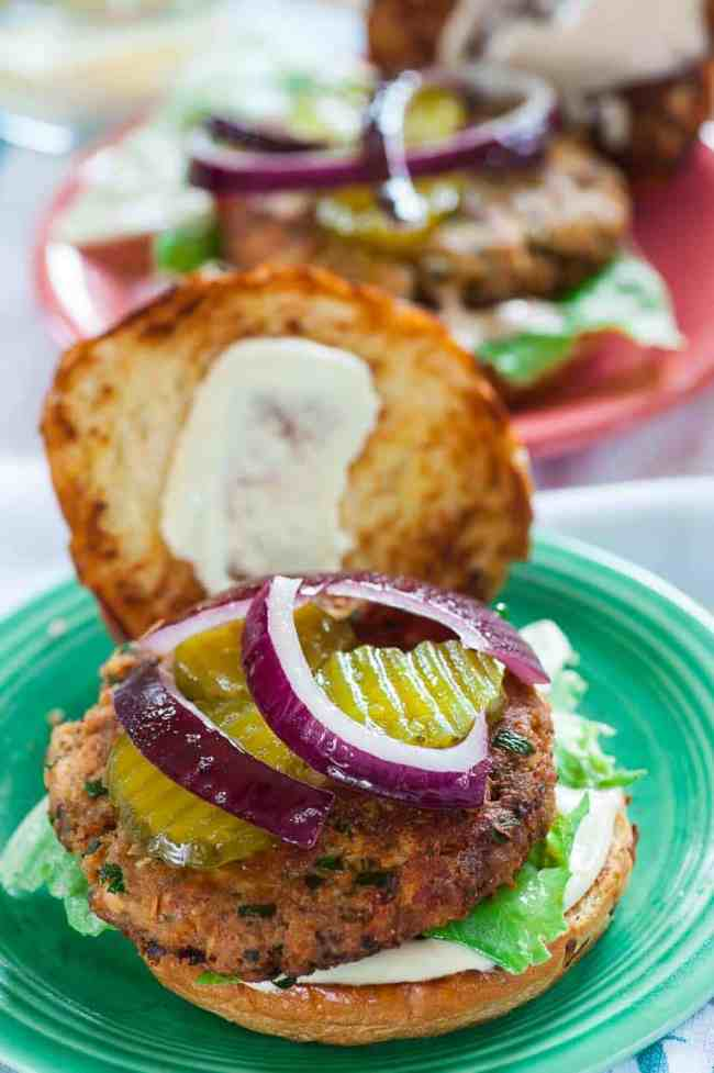 Salmon patty sandwiches on toasted buns are easy, inexpensive and taste so good. | joeshealthymeals.com