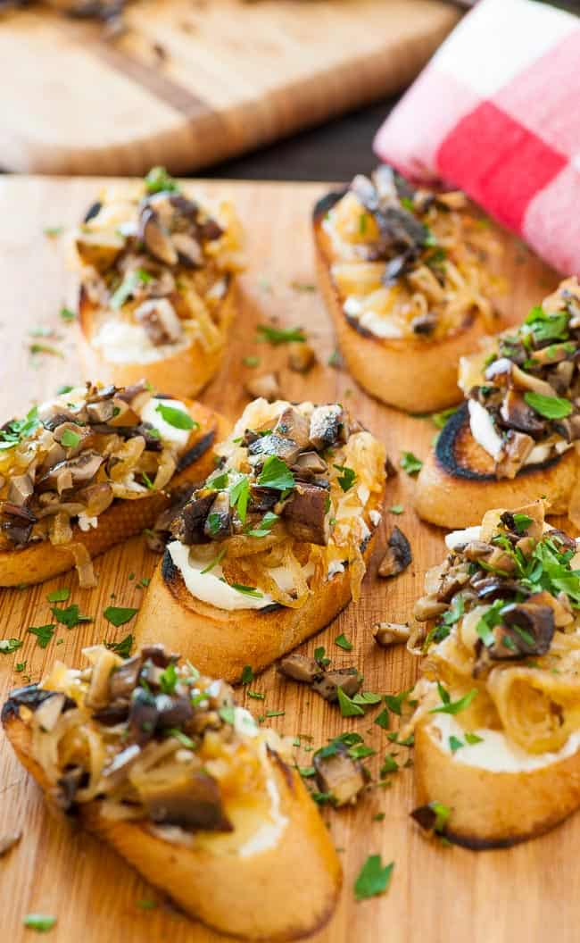 Caramelized onion crostini with mushrooms. Perfect appetizer for holidays, bowl games, NFL playoffs and the Super Bowl.   joeshealthymeals.com
