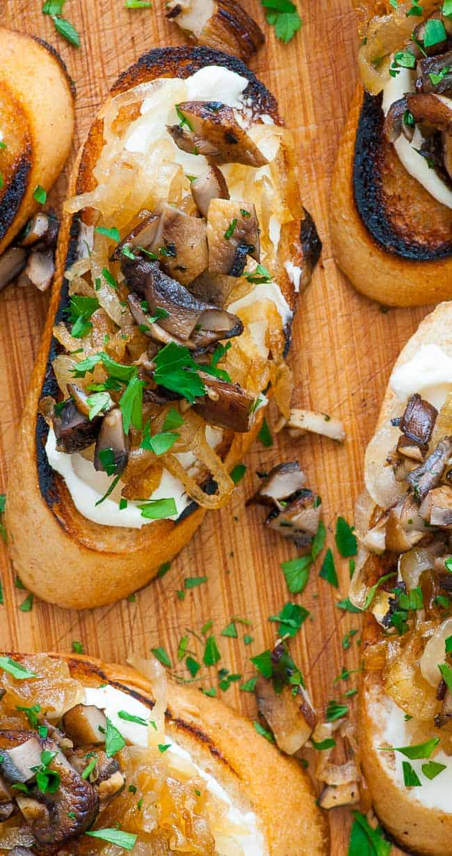 caramelized onion crostini. Caramelized onion crostini with mushrooms. Perfect appetizer for holidays, bowl games, NFL playoffs and the Super Bowl. | joeshealthymeals.com