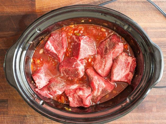 Crock pot full of beef ragout ingredients