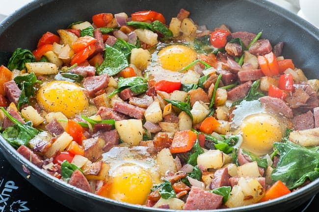 Breakfast hash with bacon and salami. Add a fried egg for a perfect meal.   joeshealthymeals.com