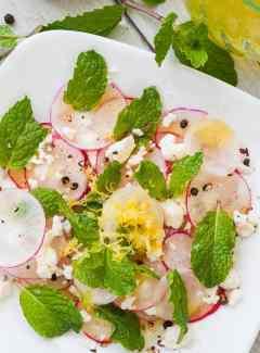 Shaved radish salad on a white plate. | joeshealthymeals.com