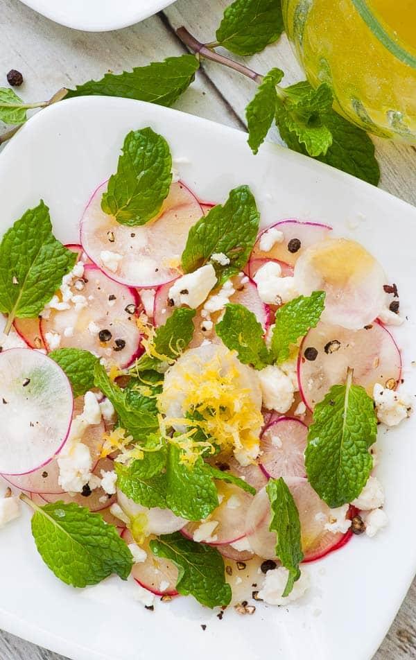 Shaved radish salad with feta, mint leaves, crushed peppercorns, and sea salt.   joeshealthymeals.com