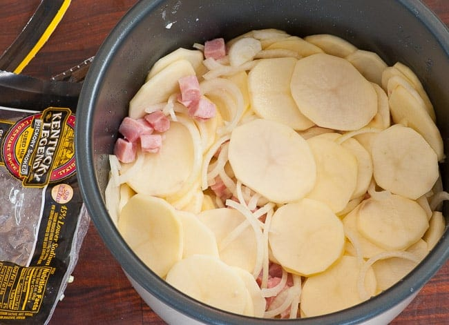 Preparing the potatoes in the pressure cooker pot.