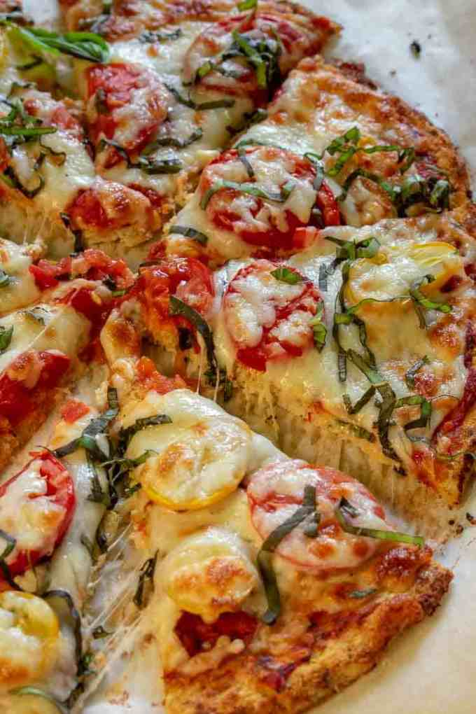 Cauliflower Crust Margherita Pizza, a tasty, gluten free alternative to flour crust. | joeshealthymeals.com