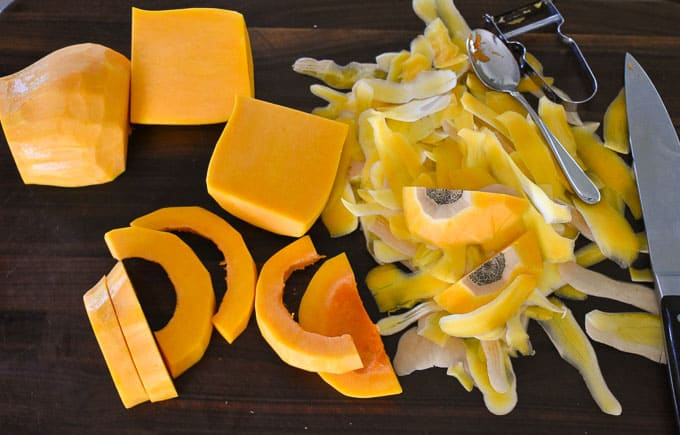 Cutting the butternut squash into slices.