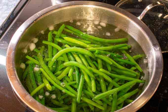 blanched beans cooling in an ice bath