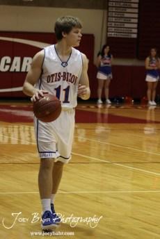 Otis-Bison Cougar Dylan Wissman (#11) dribbles the ball down the court against the Ellsworth Bearcats at the 2012 Hoisington Winter Jam Basketball Tournament.