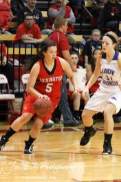 Hoisington Lady Cardinal BreAnna Burns (#5) takes the ball over in the Russell Lady Broncos end at the 2012 Hoisington Winter Jam Basketball Tournament.