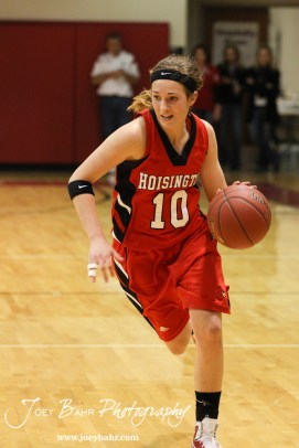 Jordin Greer (#10) of the Hoisington Lady Cardinals drives towards the Russell Lady Broncos defense at the 2012 Hoisington Winter Jam Basketball Tournament.