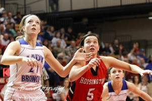 Russell Lady Bronco Kelli Rourke (#21) and Hoisington Lady Cardinal BreAnna Burns (#5) go for a rebound after a free throw attempt at the 2012 Hoisington Winter Jam Basketball Tournament.