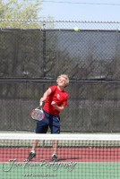 A Dodge City player serves the ball during the Great Bend Invitiational Boys Tennis Tournament at Great Bend High School in Great Bend, Kansas on March 31, 2012. (Photo: Joey Bahr, www.joeybahr.com)