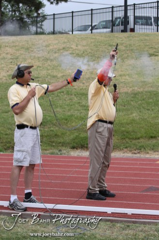 The starter fires his gun at the start of a heat during the 2012 KSHSAA State Track and Field Championship at Cessna Stadium on the campus of Wichita State University in Wichita, Kansas on May 25, 2012. (Photo: Joey Bahr, www.joeybahr.com)