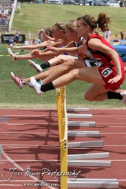 Competitors leap over a line of hurdles in a heat of the Class 3A Girls 100 Meter High Hurdles during the 2012 KSHSAA State Track and Field Championship at Cessna Stadium on the campus of Wichita State University in Wichita, Kansas on May 25, 2012. (Photo: Joey Bahr, www.joeybahr.com)