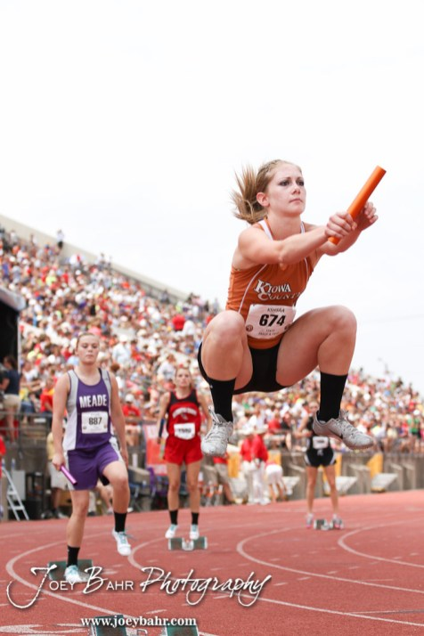 Kiowa County's Katelynn Gamble loosens up for the First Leg of the Class 2A Girls 4x100 Meter Relay Preliminaries during the 2012 KSHSAA State Track and Field Championship at Cessna Stadium on the campus of Wichita State University in Wichita, Kansas on May 25, 2012. (Photo: Joey Bahr, www.joeybahr.com)