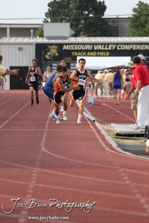 Two members of the Holcomb Boys 4x400 Meter team hand off the barton during the 2012 KSHSAA State Track and Field Championship at Cessna Stadium on the campus of Wichita State University in Wichita, Kansas on May 25, 2012. (Photo: Joey Bahr, www.joeybahr.com)