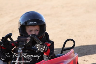Gratton Dalton(#73) waits to start a heat race at the Ness County Speedway Kart Races sponsored by Walker Tank Service at Ness County Speedway in Ness City, Kansas on August 18, 2012. (Photo: Joey Bahr, www.joeybahr.com)