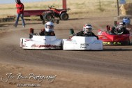 Nate Gabel(#95) takes the lead from Tyler Walker(#20) in the Junior 2 Light Class Heat 1 at the Ness County Speedway Kart Races sponsored by Walker Tank Service at Ness County Speedway in Ness City, Kansas on August 18, 2012. (Photo: Joey Bahr, www.joeybahr.com)