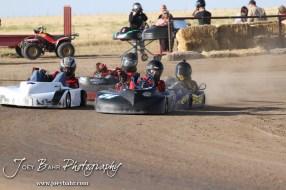 Racers restart Heat 1 of the Junior 2 Heavy Class at the Ness County Speedway Kart Races sponsored by Walker Tank Service at Ness County Speedway in Ness City, Kansas on August 18, 2012. (Photo: Joey Bahr, www.joeybahr.com)