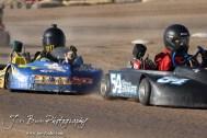 Sierra Swart(#54) and Jeremy Huish(#88) race in Heat 1 of the Junior 2 Heavy Class at the Ness County Speedway Kart Races sponsored by Walker Tank Service at Ness County Speedway in Ness City, Kansas on August 18, 2012. (Photo: Joey Bahr, www.joeybahr.com)