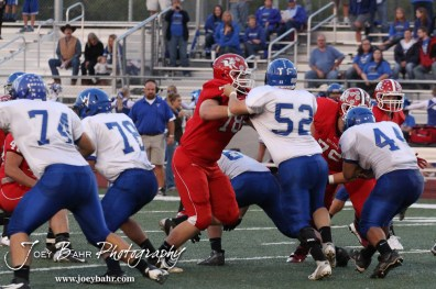 Winfield Viking Craig Archambeau (#52) tries to block McPherson Bullpup Garrett Larson (#78) during the Winfield at McPherson football game that ended in a 47 to 8 victory for the Bullpups at the McPherson Stadium in McPherson, Kansas on September 28, 2012. (Photo: Joey Bahr, www.joeybahr.com)