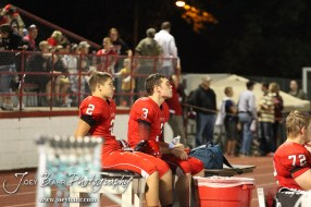 McPherson Bullpups Tanner Hamilton (#2) and Alex Bahr (#3) relax on the sidelines during the Winfield at McPherson football game that ended in a 47 to 8 victory for the Bullpups at the McPherson Stadium in McPherson, Kansas on September 28, 2012. (Photo: Joey Bahr, www.joeybahr.com)