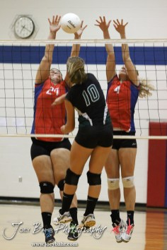 Ellinwood Lady Eagles Kelsea Ward (#27) and Lindsey Zink (#4) block a shot from Central Plains Lady Oiler Breanna Holmes (#10) during the Central Plains Lady Oilers at Ellinwood Lady Eagles volleyball match at Ellinwood High School in Ellinwood, Kansas on October 11, 2012. (Photo: Joey Bahr, www.joeybahr.com)