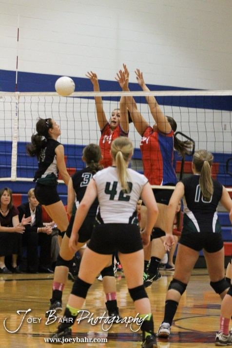 Ellinwood Lady Eagles Devann Patten (#14) and Kelsea Ward (#27) block the ball back over the net during the Central Plains Lady Oilers at Ellinwood Lady Eagles volleyball match at Ellinwood High School in Ellinwood, Kansas on October 11, 2012. (Photo: Joey Bahr, www.joeybahr.com)