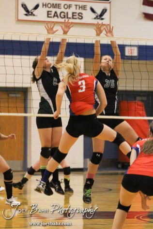 Central Plains Lady Oilers Kendra Oberle (#8) and Jennifer Hitschmann (#35) set a wall for a shot from Ellinwood Lady Eagle Sophie Hayes (#3) during the Central Plains Lady Oilers at Ellinwood Lady Eagles volleyball match at Ellinwood High School in Ellinwood, Kansas on October 11, 2012. (Photo: Joey Bahr, www.joeybahr.com)