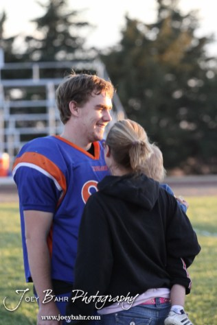 Otis-Bison Cougar Matthew Demel (#88) greets his family before the Wilson High School at Otis-Bison High School Eight Man Division II District 7 matchup with Otis-Bison winning 60-14 in Otis, Kansas on October 19, 2012. (Photo: Joey Bahr, www.joeybahr.com)