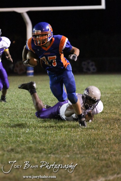 Otis-Bison Cougar Justin Jecha (#17) evades the tackle of Wilson Dragon Jordan Bess (#11) during the Wilson High School at Otis-Bison High School Eight Man Division II District 7 matchup with Otis-Bison winning 60-14 in Otis, Kansas on October 19, 2012. (Photo: Joey Bahr, www.joeybahr.com)