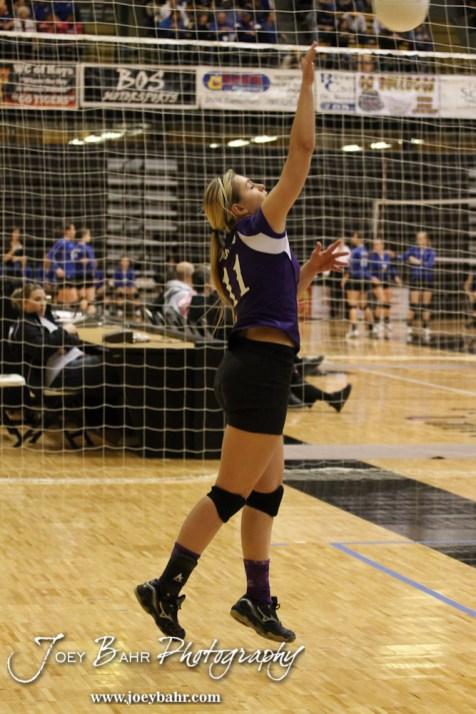 Wilson Lady Dragon Karlie Steinle (#11) serves during the Wilson versus Weskan KSHSAA Class 1A Division II State Volleyball Pool II match with Weskan winning 26-24, 25-12 in Hays, Kansas on October 26, 2012. (Photo: Joey Bahr, www.joeybahr.com)