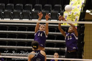 Wilson Lady Dragons Antjelica Pfannenstiel (#14) and Shania Steinike (#13) set a wall during the Wilson versus Weskan KSHSAA Class 1A Division II State Volleyball Pool II match with Weskan winning 26-24, 25-12 in Hays, Kansas on October 26, 2012. (Photo: Joey Bahr, www.joeybahr.com)